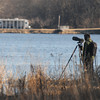 Amesbury: A birder waits patiently in the high grass on Deer Island in Amesbury. A number of bald eagle have been sighted near the island over the past few weeks. Jim vaiknoras/staff photo