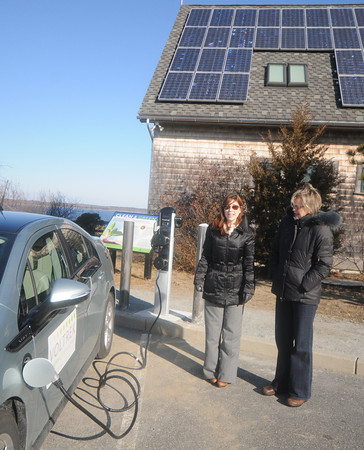 Newburyport: Kathleen Rossen, left, of Voltrek demostrates an electric fueling station with Melissa Vokey at the Joppa Flats Audobon Center on the Plum Island Turnpike in Newburyport. JIm Vaiknoras/staff photo