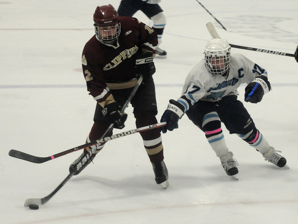 Stoneham: Newburyport's Payson Cahill  fights his way up the ice against Wilmington at Stoneham Arena. Jim Vaiknoras/staff photo