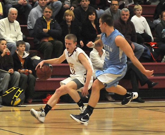 Newburyport: Newburyport's Adam Traxler turns the corner on Triton's Blaise Whitman during their game at Newburyport Tuesday night. Jim Vaiknoras/staff photo