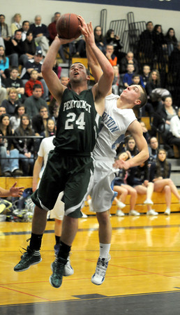 Newbury: Pentucket's Nolan Dragon has his shot blocked by Triton's Jedd Hutchins during their game at Triton Friday night. Jim Vaiknoras/staff photo