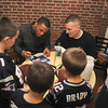 Newburyport: New England Patriot's defensive back Patrick Chung, with some help from Tyke Karopoulos, signs autographes for Charlie , Max, Will and Lucy Gagnon at the Port City Sandwich Shop Saturday morning. The event was a fund raiser for a scholarship in the name of the Trista Zinck, who was killed by a drunk driver in 2003. JIm Vaiknoras/staff photo