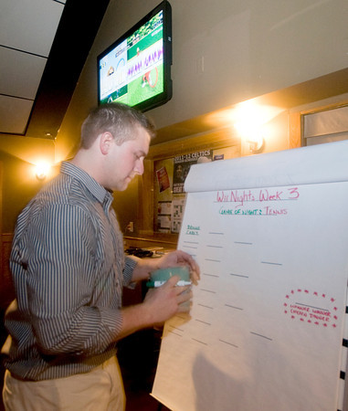 Newburyport: Michael's Harborside manager Ben Treshinsky fills out the brackets for Wii night . Jim Vaiknoras/staff photo