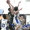Stoneham: Pentucket's Will Angelini grabs a rebound during the Sachems game at Stoneham Saturday night. Jim Vaiknoras/staff photo