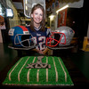 salisbury: Kira Duford poses with a Superbowl cake she made working at the Winner Circle in Salisbury Sunday night. JIm vaiknoras/staff photo