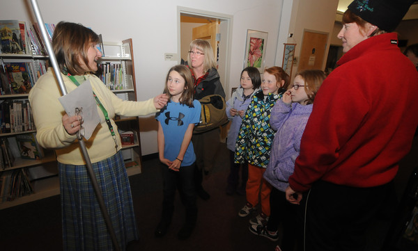 Newbury: Newbury's Childrens Librarian Laurie Collins talks with Samantha Protopapas, along with her mom Deb Protopapas, Arianna Stevens, Kerry ans Erin Powers and Sue Powers. Laurie is leaving the Newbury Library to take a job at the Ipswich Library. Jim Vaiknoras/staff photo