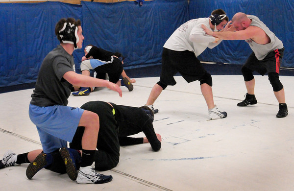 Byfield: Members of the Triton High wrestling team practice for their upcoming match this weekend. Bryan Eaton/Staff Photo