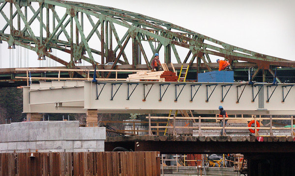 Amesbury: The center span of the Hines Bridge is in place supported by two new piers made of concrete. Bryan Eaton/Staff Photo