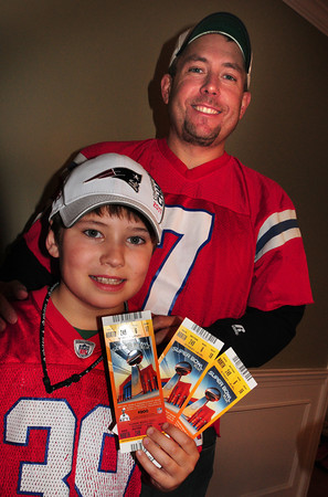 Newburyport: Ryan Meleedy, 10, of Newburyport and his dad Tim have their Superbowl tickets and are driving out to Indianapolis with a family friend on Friday morning. Bryan Eaton/Staff Photo
