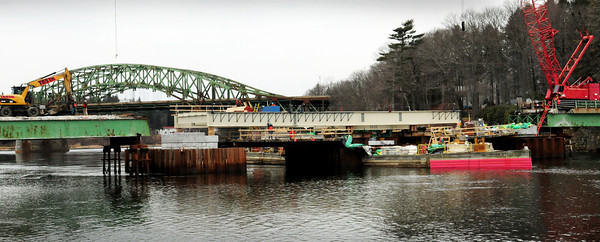 Amesbury: The new Hines Bridge is taking shape as the new center span has been put in place, this view from Deer Island. Bryan Eaton/Staff Photo