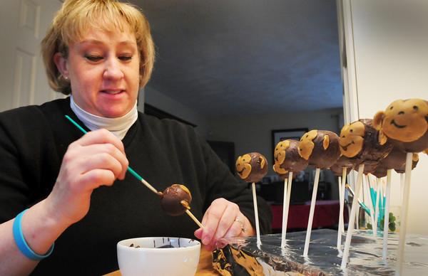 Merrimac: Kathy Terceiro decorates her monkey cake pops. Bryan Eaton/Staff Photo
