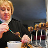 Merrimac: Kathy Terceiro decorates her monkey cake pops. Bryan Eaton/Staff Photo