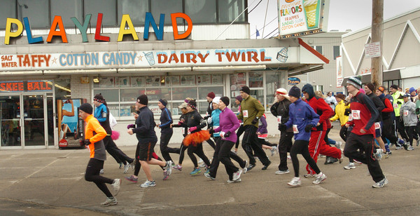 Salisbury: Runners in the Frosty Knuckle begin their 5K race at Salisbury Beach Center heading to the Salisbury Beach State Reservation by roadway then coming back along the beach on Saturday morning. Bryan Eaton/Staff Photo