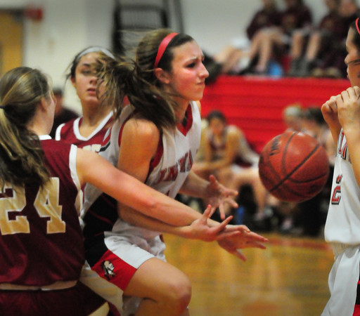 Amesbury: Amesbury's #10 gets fouled by Newburyport's Lilly Donovan. Bryan Eaton/Staff Photo