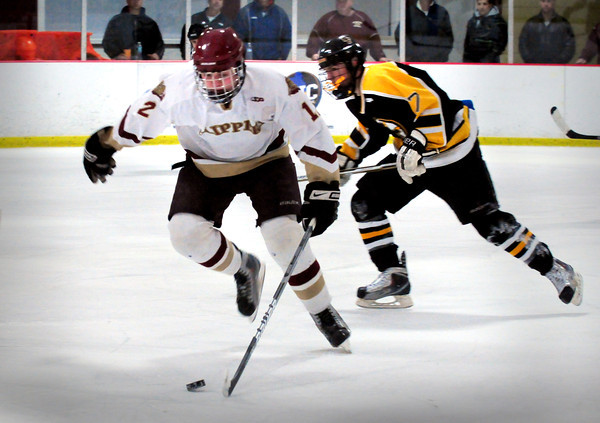 Newburyport: Clipper's Payson Cahill gets the puck away from Bishop Fenwick's Mike Cipriani last night at the Graf Rink. Bryan Eaton/Staff Photo