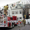 Amesbury: Newburyport Fire Department's ladder truck assisted Amesbury with a two-alarm fire on Pearl Street at Elm Street yesterday morning. Bryan Eaton/Staff Photo