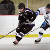 Newburyport: Triton's Mike Fish moves on Shawsheen's Mike DiGiorgio last night at the Graf Rink. Bryan Eaton/Staff Photo