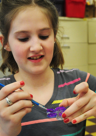 Salisbury: Sheridyn LaRocque, 10, paints a suncatcher in art class at the Boys and Girls Club on Thursday afternoon. The club will be open for next week's school vacation from 8:00a.m. to 6:00p.m. with special activities. Bryan Eaton/Staff Photo