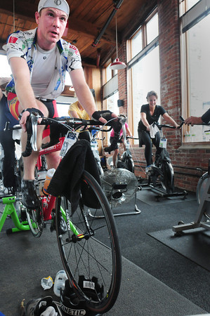 Newburyport: Brian Ladd, left, is one of a dozen people on this shift spinning at Natural High Fitness at the Tannery in Newburyport on Saturday. They were part of a nine gym effort called Spin For the Animals raising money for the MSPCA. Bryan Eaton/Staff Photo