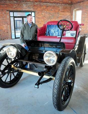 Amesbury: Bart Bailey stands with an electric car his family's company built a hundred years ago in Amesbury. Bryan Eaton/Staff Photo