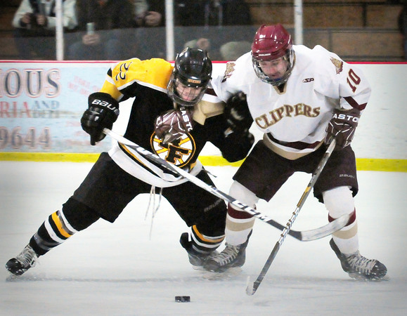 Newburyport: Bishop Fenwick's Drew Thibodeau, left, and Newburyport's Patrick Crowley go after a loose puck. Bryan Eaton/Staff Photo