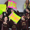 Marblehead: The Newburyport High junior varsity basketball team wave signs for Beth Castantini when she scored her 1000th high school career point yesterday in Marblehead. Bryan Eaton/Staff Photo