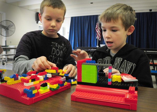 Amesbury: Spencer Butzen, 9, left, and Zachary Schneider, 8, work on a space station out of Lego's in the Amesbury Recreation Department's afterschool program on Wednesday. The got an early start as Amesbury Elementary School had a half day for staff development. Bryan Eaton/Staff Photo