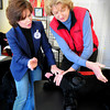 Newburyport: Kathleen Burke, left, gives instruction to Linda Kay using a stuff canine doll to teach CPR for dogs. Bryan Eaton/Staff Photo