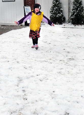 Newburyport: Emerson Clark, 6, of Newburyport runs around what snow there is outside the Newburyport Montessori School where she was playing with friends yesterday afternoon. Snow is expected to fall throughout the day with accumulations up to a foot forecast. Bryan Eaton/Staff Photo