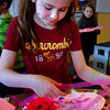 Amesbury: Emma Porter, 8, uses ribbon to decorate a heart at the Amesbury Elementary School on Monday. She was constucting a folder to keep her cards that she'll swap with classmates at their Valentine's Day party. Bryan Eaton/Staff Photo