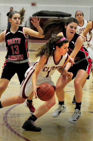 Newburyport: Newburyport's Aly Leahy moves the ball down court past North Andover defenders last night. Bryan Eaton/Staff Photo