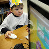 Amesbury: Lucas Reese, 5, works in the computer lab at Amesbury Elementary School wearing his 100th day of school hat on Thursday. The 100th day also coincided with their 100th Read Aloud Day and several classes brought their books and wearing pajamas spent the day reading.