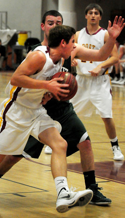 Newburyport: Newburyport's Colton Fontaine moves by Pentucket's Nolan Dragon last night at Newburyport High. Bryan Eaton/Staff Photo