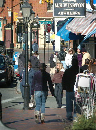 Newburyport: Downtown Newburyport was busy yesterday afternoon for the President's Day holiday, though many were bundled up. With school out and temperatures rising mid-week it may stay that way. Bryan Eaton/Staff Photo