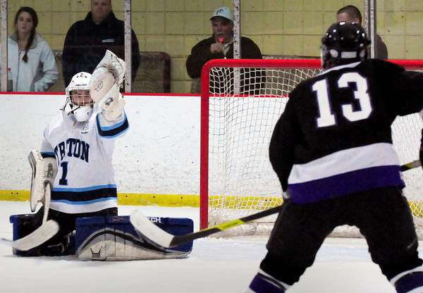Newburyport: Triton goalie Carl Orlandi catches the puck on a shot by Shawsheen's Joe Sodergren. Bryan Eaton/Staff Photo