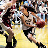 West Newbury: Pentucket's Alex Moore moves the ball into Newburyport territory as Clipper's Mary Pettigrew defends last night in West Newbury. Bryan Eaton/Staff Photo