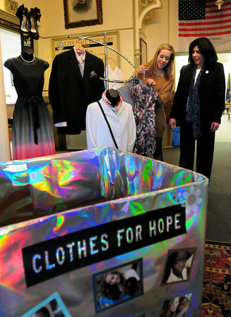 Newburyport: Lauren Sundstrom shows some clothing she's collected for the Clothes for Hope to be resold with the proceeds helping students in Ghana. The mayor allowed Lauren to put a box in City Hall to accept donations of new or slightly used clothes. Bryan Eaton/Staff Photo