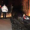 Amesbury: Amesbury building inspector Denis Nadeau and fire officials look over a rolled over car that had three occupants in it as it landing against the Hatter's Point Condominiums in Amesbury last night. Bryan Eaton/Staff Photo