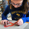 Salisbury: Danielle Bradanese, 9, uses chalk to create concentric hearts for a Valentine's Day art project. The children were using pastel-colored chalk to create the hearts or snowflakes in Shannon O'Brien's art class at Salisbury Elementary School on Monday. Bryan Eaton/Staff Photo