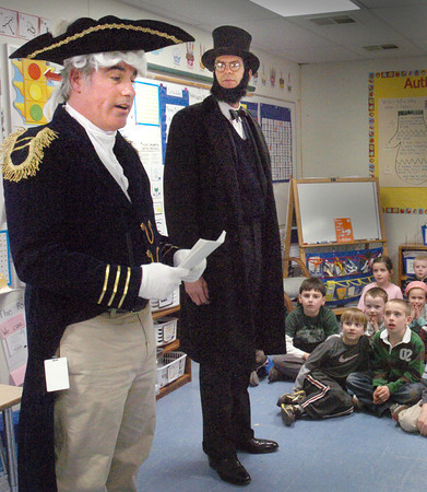 Newburyport: George Washington, left, and Abraham Lincoln, a.k.a. Morgan Stebbins and Gus Harrington respectively, talk to first-graders at the Bresnahan School in Newburyport on Wednesday. They presented biographies of their characters as the children have been studying a unit on the presidents of the United States. Bryan Eaton/Staff Photo