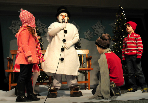 "Amesbury: Devin Gannon takes the lead role in the Amesbury Elementary School play ""Runaway Snowman"" in a performance for parents on Wednesday. Another performance of the play, put together by teacher Liz Morris and Billie McLane, was to be presented on Thursday as well. Bryan Eaton/Staff Photo"