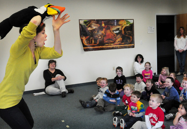 Newburyport: Tulley the Toucan gets laughs out of children at Mrs. Murray's Nursery School in Newburyport on Monday morning. Lindsay Bezich brought her array of large puppets to entertain the youngsters. Bryan Eaton/Staff Photo