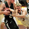 Newburyport: Pentucket's Nolan Dragon, left, gets the scramble from Newburyport's Dillon Guthro. Bryan Eaton/Staff Photo