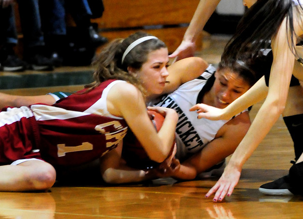 West Newbury: Newburyport's Aly Leahy, left, and Pentucket's Sarah Higgins wrestle with a loose ball. Bryan Eaton/Staff Photo