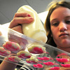 Newburyport: Anna Marcheterre, 13, squeezes warm white chocolate into molds with pink sprinkles on the bottom to harden into heart-shaped candy. Teens at the Newburyport Public Library were making the candy and doing cookie decorating for Valentine's Day. Bryan Eaton/Staff Photo