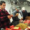 Newburyport: Volunteers empty packages of stuffing to make topping for turkey pot pie, instead of using pastry crust, last night at the Salvation Army's weekly Thursday night supper. From left, Bobby Philps, Tony Mazzaglia and Lion's Club member Frank Ventura who was there with half dozen members of his organization who were volunteering last night. Bryan Eaton/Staff Photo