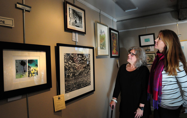 Newburyport: Christotha Fitzmaurice, left, of Chameleon and Kari Bernard of Walsingham Gallery are judging the winter show of the Newburyport Art Association. Bryan Eaton/Staff Photo