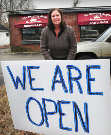 Amesbury: Whistling Kettle owner Maura Costello has signs in front of her Amesbury breakfast and lunch spot letting customers know she is open. Bryan Eaton/Staff Photo