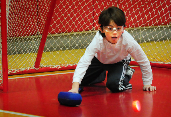 Amesbury: Liam Davey, 9, has his eyes on the puck as he makes a save during a game of floor hockey Monday morning. He was in Ted Flaherty's gym class at the Cashman School in Amesbury. Bryan Eaton/Staff Photo