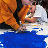 Newburyport: Jeffrey Thurston, right, reads off the spelling of the Yangtze River as Keenan Jackson, both 7, writes it onto a map they made in Kristin Callahan's class at the Bresnahan School on Thursday. As part of their geography lessons children chose a continent to study and made a map of it and filled in rivers and mountain ranges. Bryan Eaton/Staff Photo